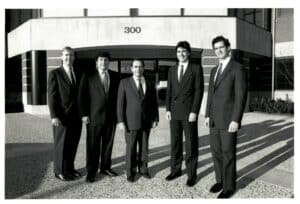 Black and white picture from 1989 of five men who work for Tonry
